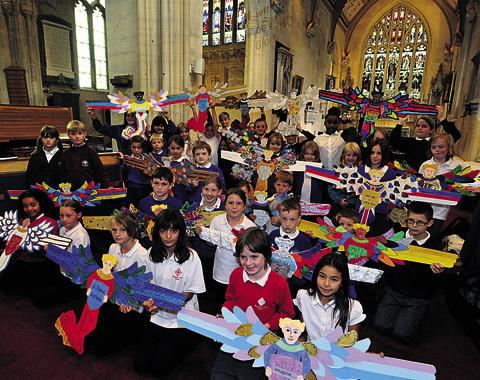 This Is Wiltshire: Trowbridge youngsters with the angels they created for the launch of the first Trowbridge Arts Festival in St James' Church
