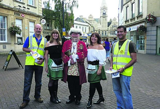 Ann Jones, Caroline Smyth, Andrew Mullens, Deon Erlek and Town Crier Trevor Heeks get in the mood for next month's Barvarian bierkeller and oompah night