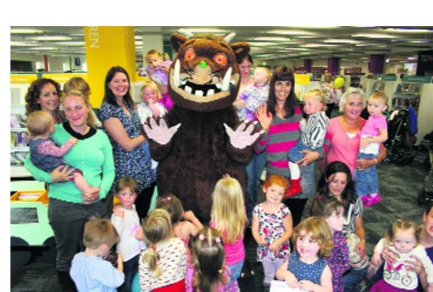 This Is Wiltshire: Mums and their pre-school youngsters meet up with the Gruffalo at the new Trowbridge Library last week