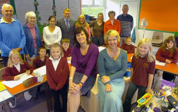 Devizes MP Clare Perry at Chirton Primary School with staff, including head teacher Sue Chivers, and pupils