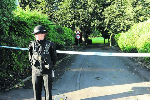 This Is Wiltshire: A police cordon at the scene today