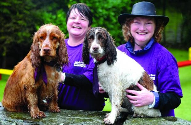 four-legged friends Claire Warwick, left, and Louise Hawes with Rusty and Skye