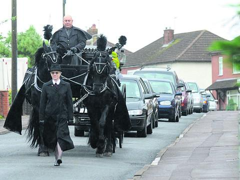 This Is Wiltshire: The funeral cortege for Shaun Hulbert