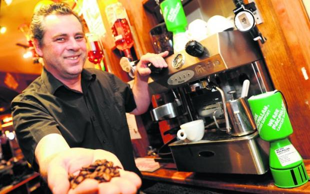 This Is Wiltshire: Fancy a cuppa? Nick Horner, the landlord of the Woodland Edge pub, which is taking part in the fundraiser Picture: SIOBHAN BOYLE