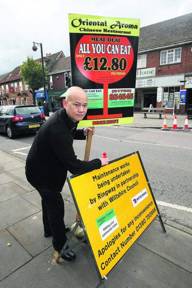 This Is Wiltshire: James Huynh, of Oriental Aroma is angry that roadworks in High Street have affected his business