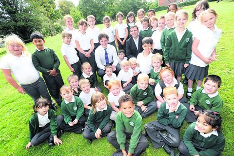 This Is Wiltshire: Headteacher Chris Cannings, centre right, and beside him deputy head Steven Rafferty with Ivy Lane Primary School pupils