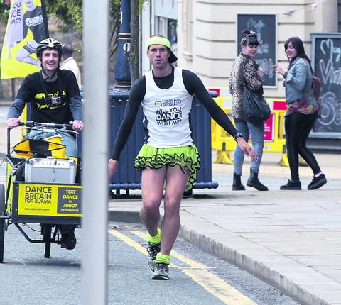 This Is Wiltshire: Ben Hammond dancing through the streets of Huddersfield on his rhythmic journey from John O'Groats towards Land's End, via his Wiltshire home town