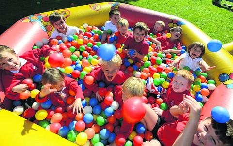 Pupils have fun in the ball pit at the celebration party