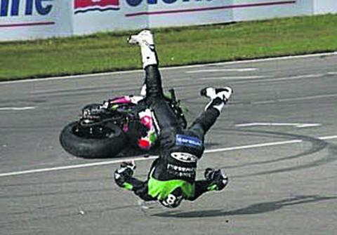 This Is Wiltshire: Victor Cox takes a spectacular tumble after his rear wheel collapsed going into the final corner of race two at the British Superbikes Championship round in Assen, Holland, last weekend   Photo: Rico Koemans