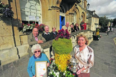 Sandra Hyde and Ruth Hopkinson, with members of Corsham in Bloom, show off the Sargent Cup and gold certificate