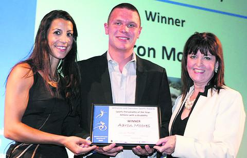 This Is Wiltshire: Aaron Moores is presented with his award by Wiltshire's 2006 Winter Olympic skeleton silver medallist Shelley Rudman and Maggie Rae, corporate joint director of public health and wellbeing, NHS Wiltshire and Wiltshire Council