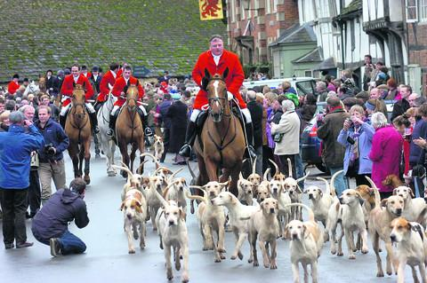 This Is Wiltshire: Jonathon Seed leading the Avon Vale Hunt out of Lacock, as master, for the final time, last Boxing Day