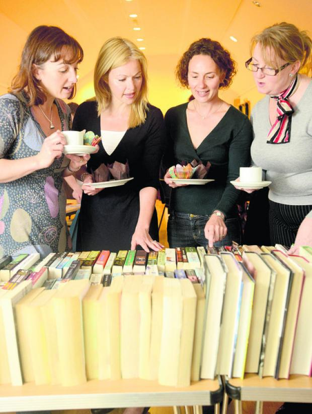 This Is Wiltshire: Caroline Haywood, Niki Connor, Charlotte Malting and Caroline Corrigan chat over some books at the coffee morning