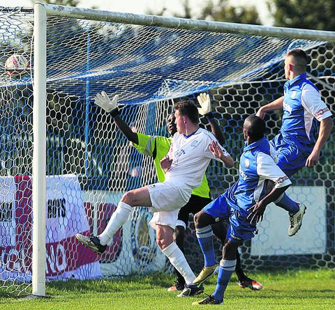 This Is Wiltshire: Brandon Barnes fires home Chippenham's winner at Bishop's Cleeve (Picture by Robin Foster)