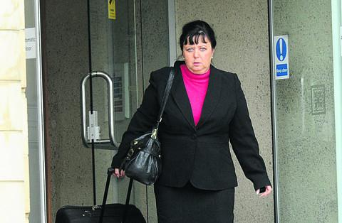 This Is Wiltshire: Wendy Coleman, who claimed to be a friend of Prince Philip and Simon Cowell, leaves court on Wednesday