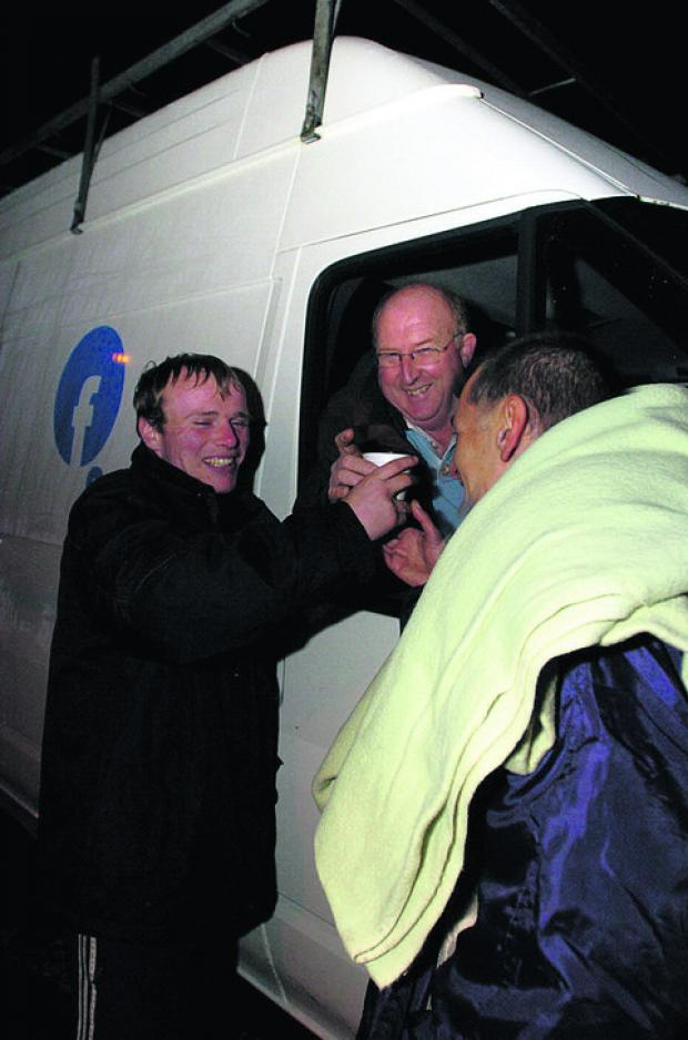 This Is Wiltshire: Chairman Angus Macpherson helping out to deliver hot drinks and food to two homeless men