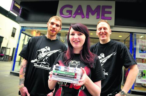 This Is Wiltshire: Staff Tony Basting and Georgina Tyson with manager James Uphill outside the store