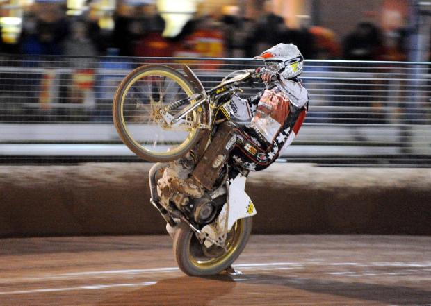 WINNING IN STYLE: Hans Andersen celebrates victory in heat five at Birmingham