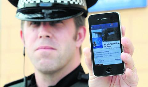 PC Matt Lewis with North Swindon Police Facebook account to engage with the community
