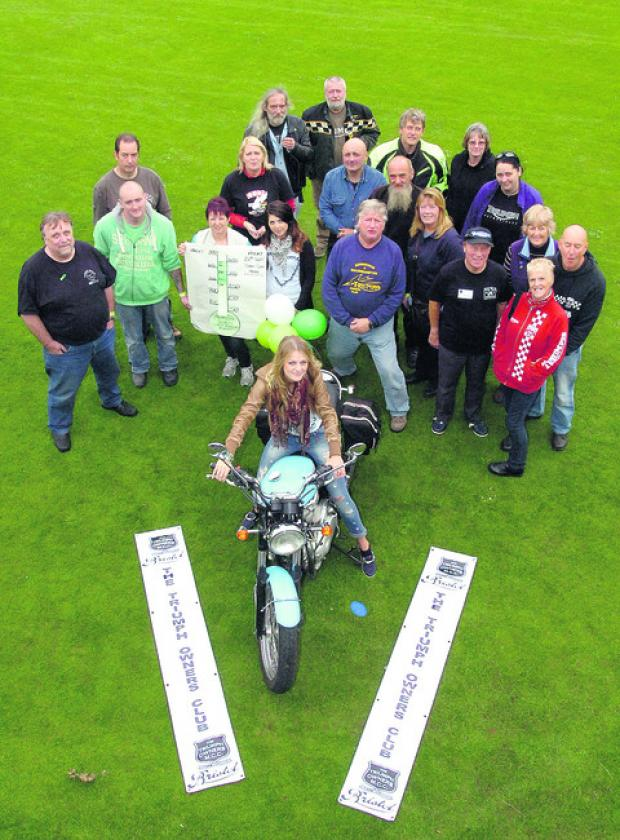 This Is Wiltshire: Kimberley Gainey, centre, from Chippenham Sports Club, with members of the Bristol Triumph Owners' Club