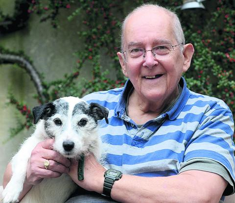 This Is Wiltshire: Tony Bolland safe at home with his dog Badger after his ordeal