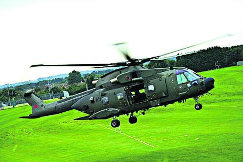 This Is Wiltshire: The helicopter touches down on the school field