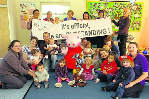 This Is Wiltshire: Staff, parents and children at Spring Rise Children's Centre celebrate the Ofsted report