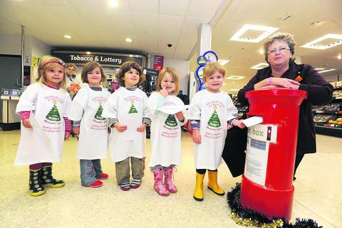 This Is Wiltshire: Lynn Clark, of Sainsbury's, Calne, launching the competition with, from left, Lily, Kacey, Angela, Maia and Summer