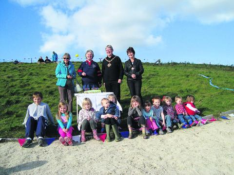 This Is Wiltshire: Some of those who visited the white horse for its 13th birthday celebrations