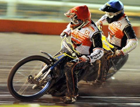 Swindon's Dawid Lampart and Troy Batchelor in action last night