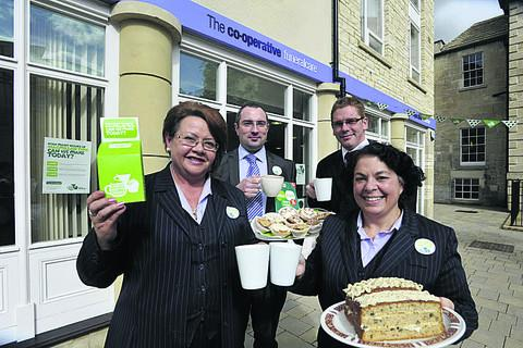 This Is Wiltshire: Co-operative Funeralcare staff in Bradford on Avon at their coffee morning. From left, Lynn Mayell, manager Mark Cowan, Paul Smith and Claire Bell