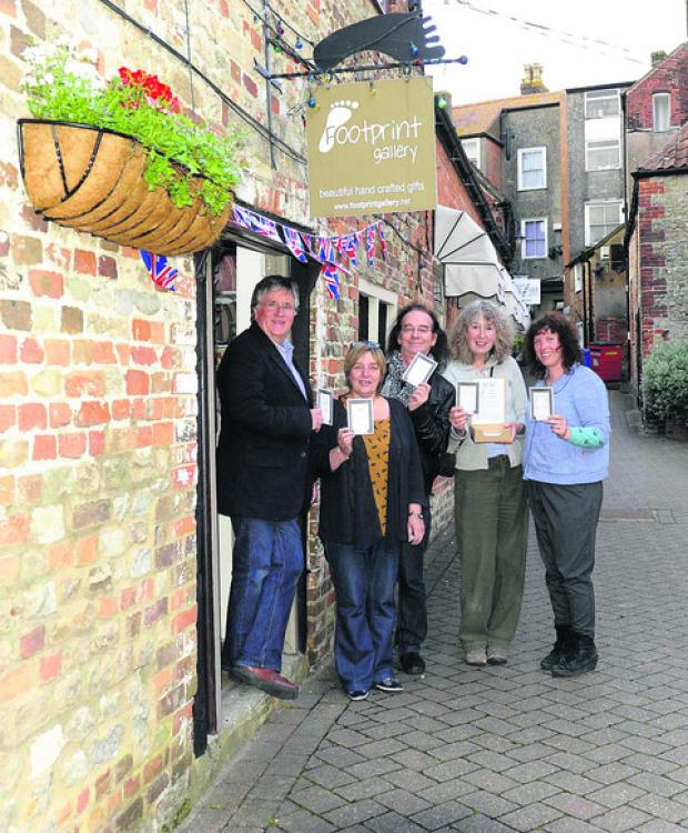 This Is Wiltshire: From left, John Leighton, Lynn Cooke, Dave Hollis, Jennie Gilling and Becky Churchill, outside the Footprint Gallery to launch Face Mail
