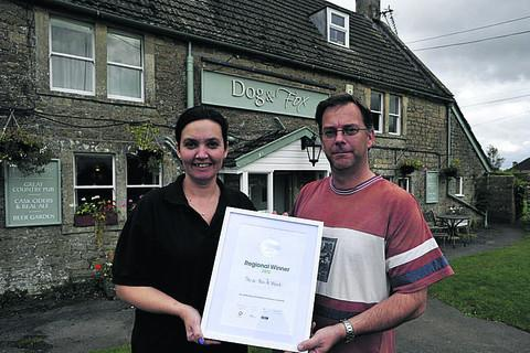 This Is Wiltshire: Andy and Joanne Wood of The Dog & Fox pub with their award
