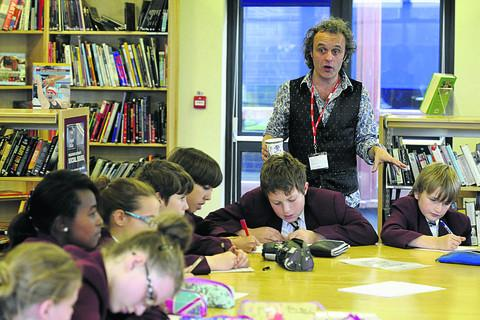 This Is Wiltshire: Author Andy Robb leads a writing workshop with pupils at St Augustine's Coll
