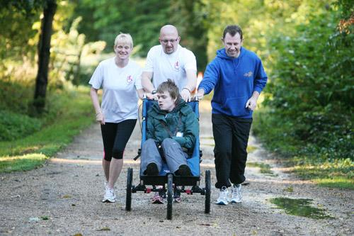 This Is Wiltshire: Heather and Reuben Smith and Paul Salmon pushing Ryan ahead of the Swindon Half Marathon