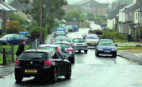 This Is Wiltshire: Traffic outside Haydon Wick Primary School