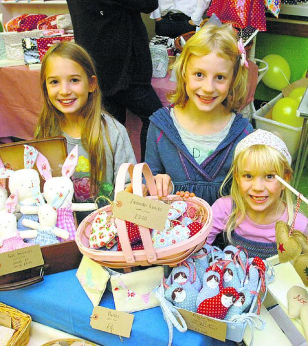 This Is Wiltshire: Emma, Lotta and Alexia enjoy the sights and sounds of the craft fair