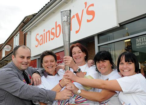 This Is Wiltshire: Staff at Sainsbury's in Haxby with the Paralympic torch; from left are Nick Horsley, Jane Stewart, store manager Nicola Oliver, Sue Phillips and Lana Sturdy
