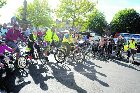 This Is Wiltshire: Cyclists of all ages line up to take part in one of the races during Saturday's Cycle Devizes! extravaganza