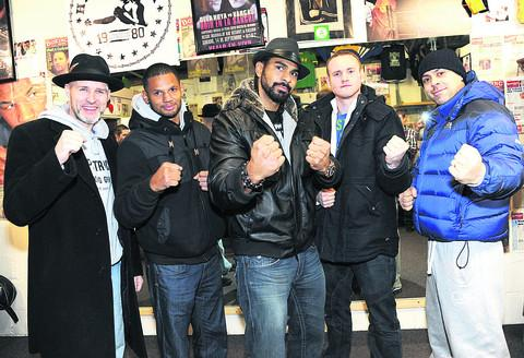 Paddy Fitzpatrick, Robert Lloyd-Taylor, David Haye, George Groves and Adam Booth at a charity boxing night run by Paddy and, below, David Haye with the WBA and WBO International Heavyweight Championship belts after beating Dereck Chisora