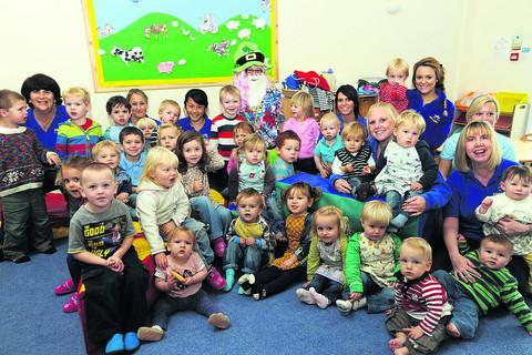 Nursery manager Charlotte Chirgwin, parents and staff with the children at Sixpenny Nursery