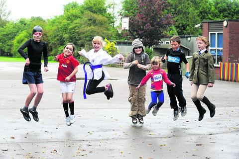 This Is Wiltshire: Joe, Emma, Georgia, Joel, Caitlin, Dylan and Evie jump for joy on their non-uniform day