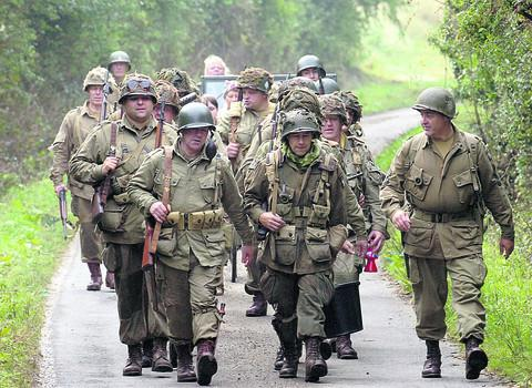 members of the Screaming Eagles Living History Group on this year's march