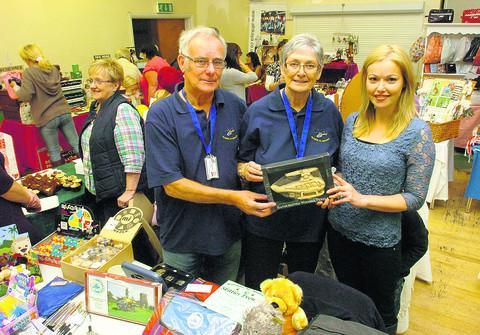 This Is Wiltshire: John and Sandra Phillips, from Wiltshire Air Ambulance, with Niki Connor, right, at Saturday's fair.