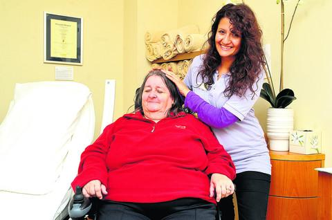 This Is Wiltshire: Norma Miller receives a treatment from Carrie Michael at the day centre