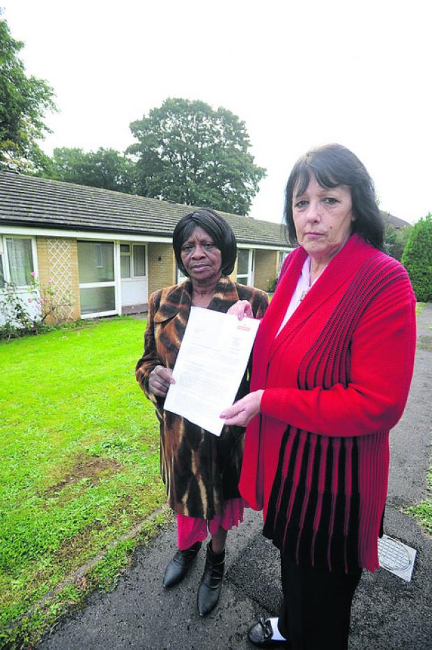This Is Wiltshire: Residents Icylin Thomas and Lynne Cosh with the letter from Royal Mail