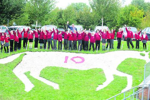 Pupils celebrate the unveiling of their white horse