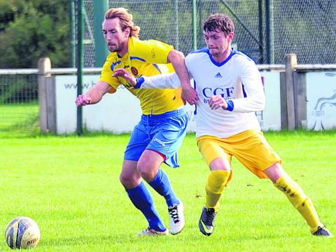This Is Wiltshire: Corsham Town Reserves Liam Fullam battles with Chippenham Park