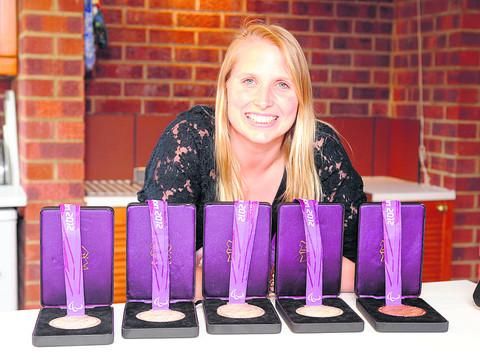 Stephanie Millward pictured with her line-up of London 2012 Paralympic medals