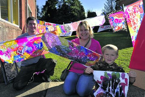This Is Wiltshire: Ben Shorter, Alison Armstrong and Joe Foale hang out their batik paintings to dry at the Big Draw at Matravers School